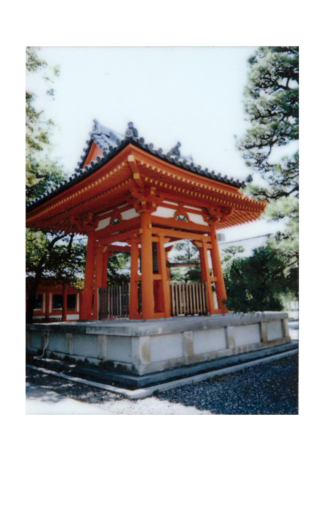 Polaroid of a small red temple in Japan